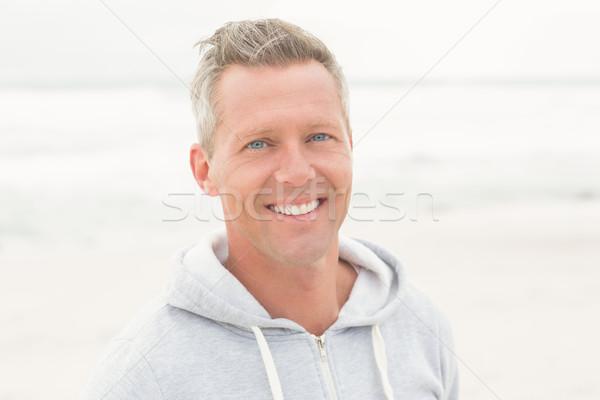 Casual man smiling at camera Stock photo © wavebreak_media