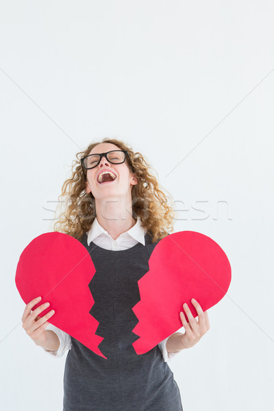 Geeky hipster holding a broken heart card Stock photo © wavebreak_media