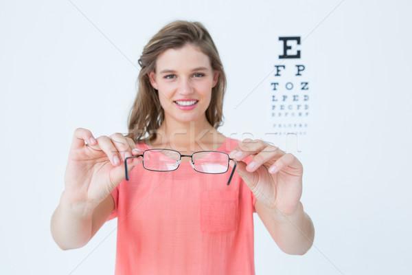 Hipszter mutat szemüveg látásvizsgálat fehér Stock fotó © wavebreak_media