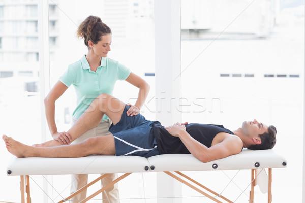 Doctor examining man leg  Stock photo © wavebreak_media