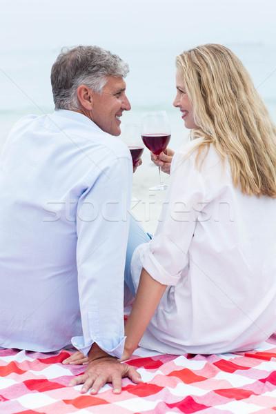 Feliz Pareja sesión manta vino tinto Foto stock © wavebreak_media