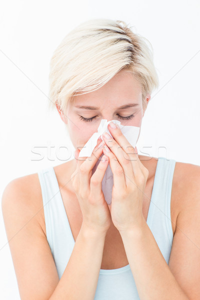 Sick woman blowing her nose Stock photo © wavebreak_media