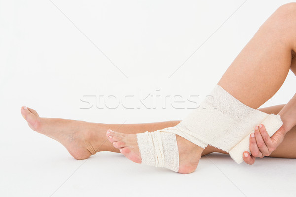 Sitting woman banding her ankle  Stock photo © wavebreak_media