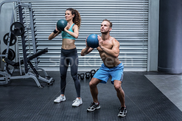 Muscular couple doing ball exercise Stock photo © wavebreak_media