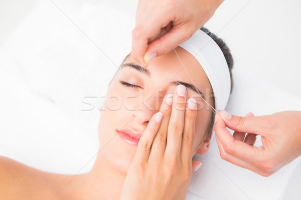 Hands threading beautiful womans upper eyes Stock photo © wavebreak_media