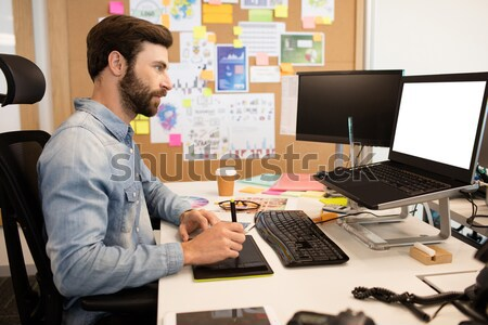 High angle view of photo editor working at desk Stock photo © wavebreak_media