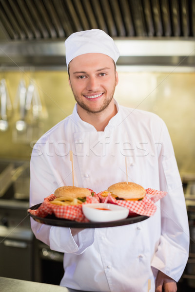 Professional chef holding burgers in plate Stock photo © wavebreak_media
