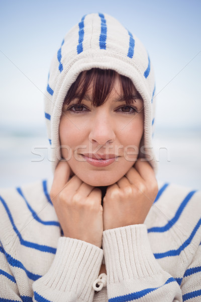 Close up portrait of woman wearing hooded sweater during winter Stock photo © wavebreak_media