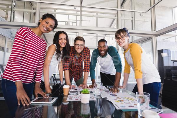 Portrait of business people standing at desk Stock photo © wavebreak_media