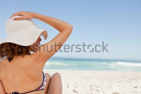 Side view of woman applying sunscream on legs Stock photo © wavebreak_media