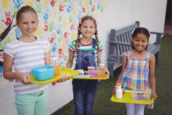 Portre mutlu öğrenciler yemek tepsi Stok fotoğraf © wavebreak_media