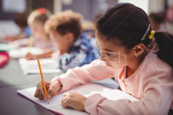 внимательный школьница домашнее задание классе школы девушки Сток-фото © wavebreak_media