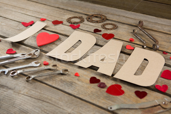 High angle view of dad text with heart shapes and work tools Stock photo © wavebreak_media
