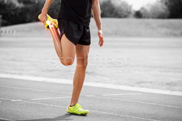 Highlighted bones of athlete man stretching on race track Stock photo © wavebreak_media