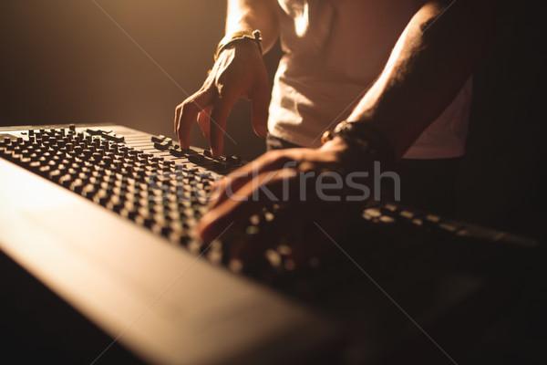 DJ operating sound mixer in illuminated nightclub Stock photo © wavebreak_media