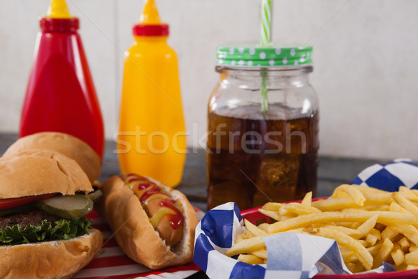 Close-up of snacks and cold drink on wooden table Stock photo © wavebreak_media