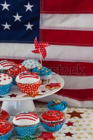 Burning sparkler on decorated cupcakes Stock photo © wavebreak_media