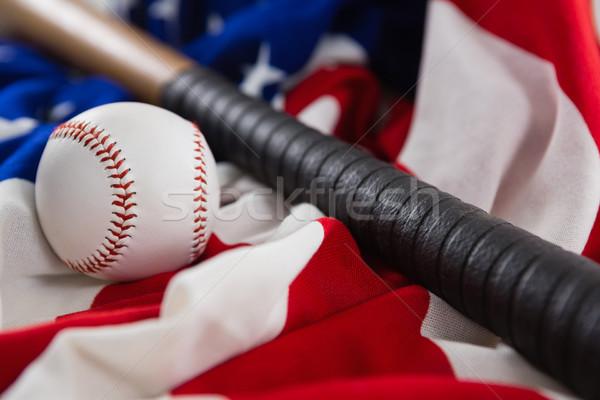 Baseball and baseball bat on an American flag Stock photo © wavebreak_media