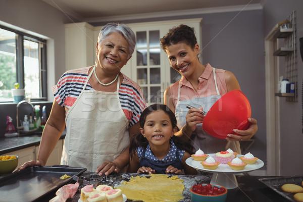 Happy family preparing desserts in kitchen Stock photo © wavebreak_media