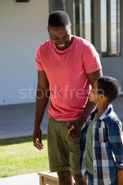 Father and son holding hands in the backyard Stock photo © wavebreak_media
