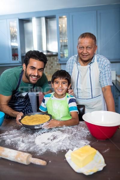 Portrait of happy family preparing food Stock photo © wavebreak_media