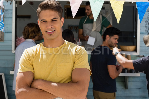 Portrait of young man with arms crossed Stock photo © wavebreak_media