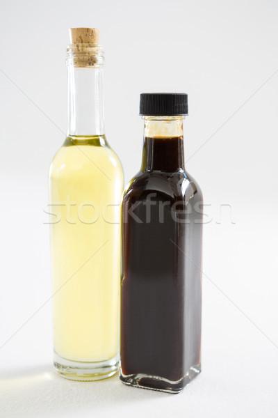 Verde roxo azeite garrafas branco comida Foto stock © wavebreak_media