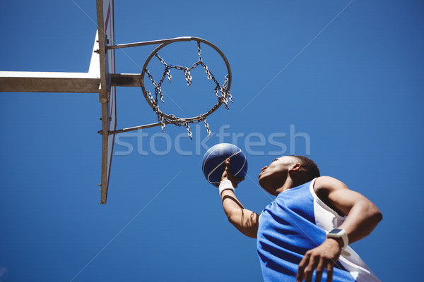 Low angle view of teenage boy playing basketball Stock photo © wavebreak_media