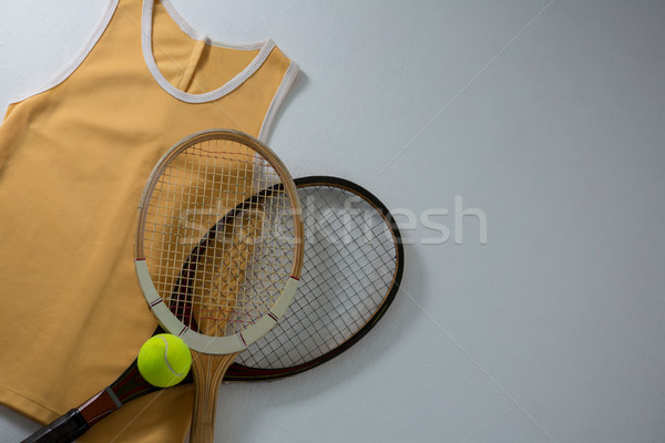 Directly above shot of rackets with vest and tennis ball Stock photo © wavebreak_media