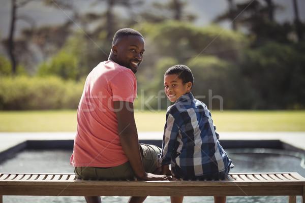 Gülen baba oğul oturma birlikte bank portre Stok fotoğraf © wavebreak_media