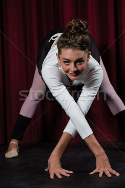Ballerina performing stretching exercise in the stage Stock photo © wavebreak_media