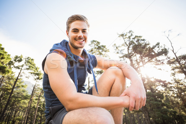 Young happy jogger sitting on rock and looking at camera Stock photo © wavebreak_media