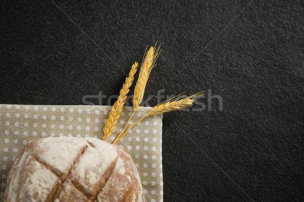 Cropped image of brown bread on napkin Stock photo © wavebreak_media