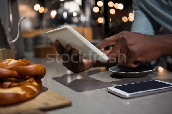 Mid section of man using digital tablet Stock photo © wavebreak_media