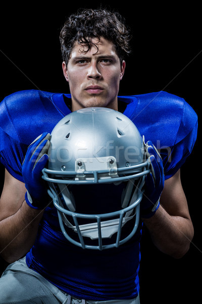 Portrait of determined sportsman holding helmet Stock photo © wavebreak_media