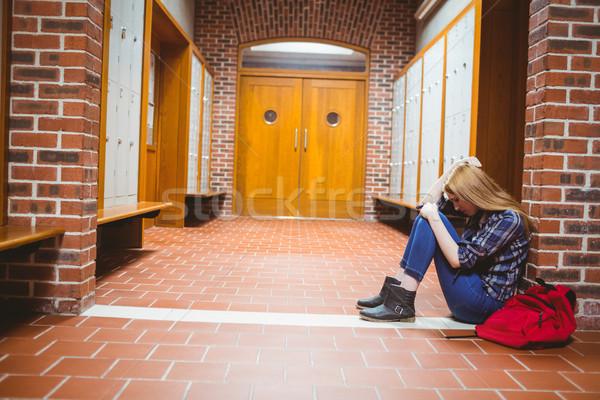 Nadenkend student vergadering vloer muur universiteit Stockfoto © wavebreak_media