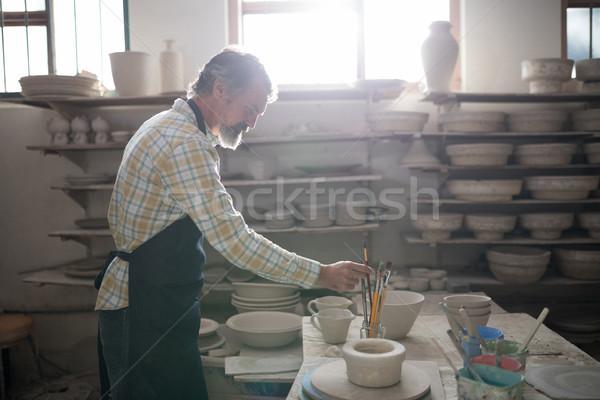 Männlich halten Pinsel Keramik Workshop Business Stock foto © wavebreak_media