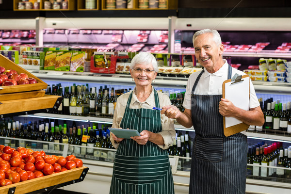 Smiling senior workers with clipboard  Stock photo © wavebreak_media