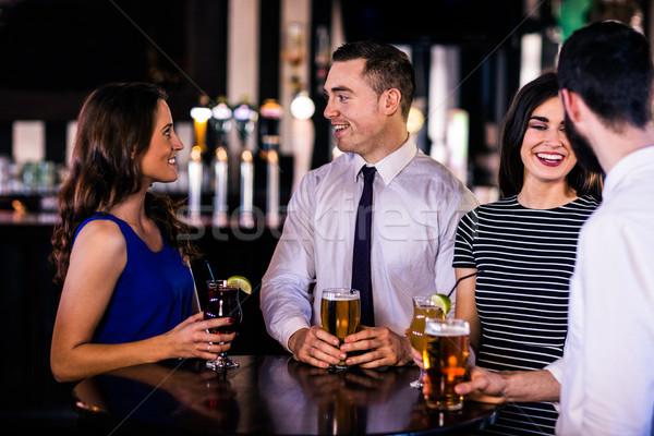 Friends talking and having a drink Stock photo © wavebreak_media