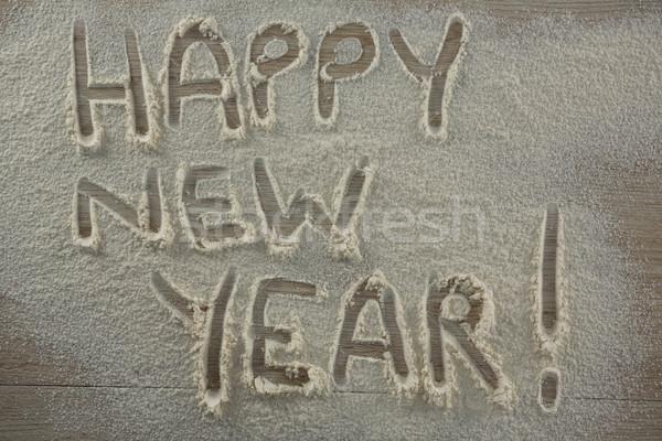 Palabra feliz año nuevo escrito harina primer plano teléfono Foto stock © wavebreak_media