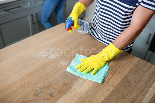 Cute couple cleaning up Stock photo © wavebreak_media