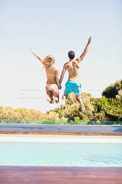 Boldog pár ugrik medence hátsó nézet nő Stock fotó © wavebreak_media