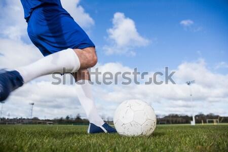 Goalkeeper ready to kick the soccer ball Stock photo © wavebreak_media