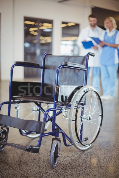 Empty wheelchair with colleagues  Stock photo © wavebreak_media