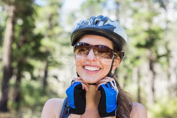 Close-up of woman adjusting helmet Stock photo © wavebreak_media