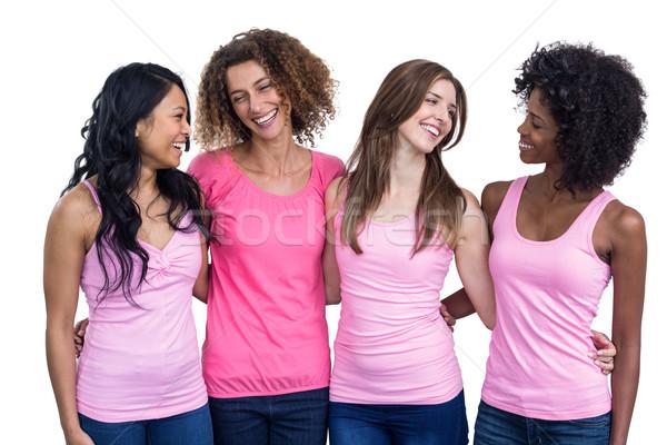 улыбаясь женщины розовый Постоянный вместе белый Сток-фото © wavebreak_media