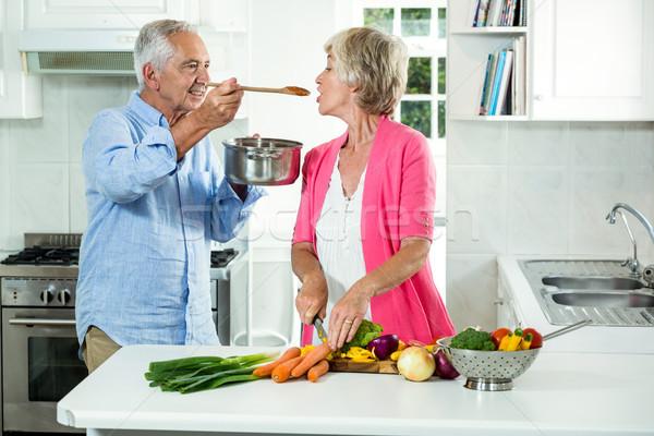 Smiling senior man feeding food to woman  Stock photo © wavebreak_media