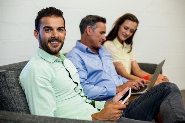 同僚 ラップトップを使用して 座って ソファ オフィス ストックフォト © wavebreak_media