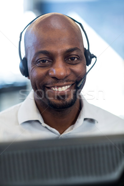 Man working on computer with headset Stock photo © wavebreak_media