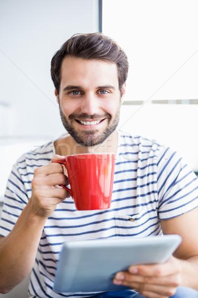 Retrato feliz homem digital comprimido Foto stock © wavebreak_media